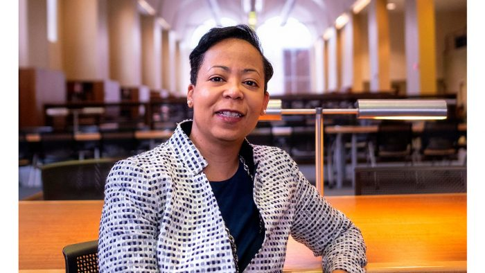 Elaine Westbrooks poses in the library