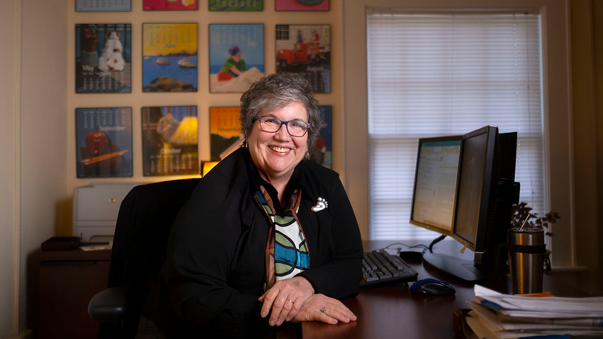 Lynn Blanchard poses for a photo in her office