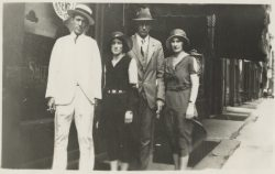 Photo of the first big country music stars Jimmie Rodgers and the Carter Family standing together on a city sidewalk..