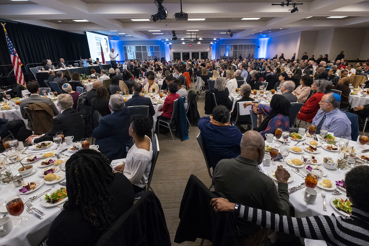 large banquet hall filled with diverse crowd
