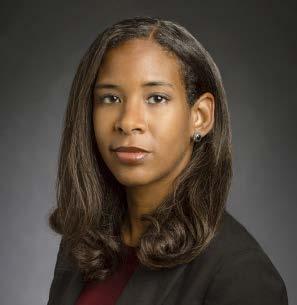 face of woman with brown hair, brown skin, dark jacket