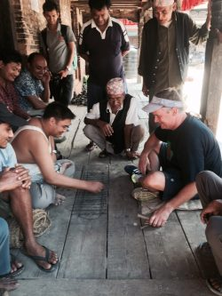 Playing a game with local men in Nepal.