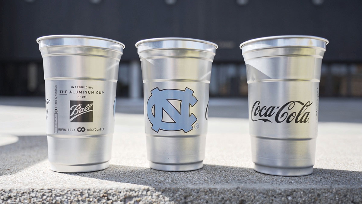 Three aluminum cups with the UNC logo