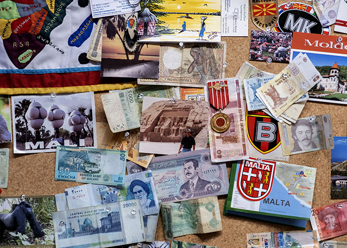 A bulletin board in Kitchen's office shows currency, tickets and other memorabilia from his many travels. (Photo by Jon Gardiner)