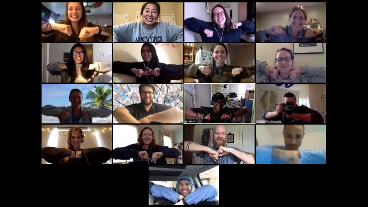 n this screenshot from the Hussman School of Journalism and Media, students in Associate Professor Chad Heartwood's Photojournalism Projects class greet each other with elbow bumps on the first day of Carolina's move to remote learning.