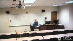 professor lectures in empty classroom