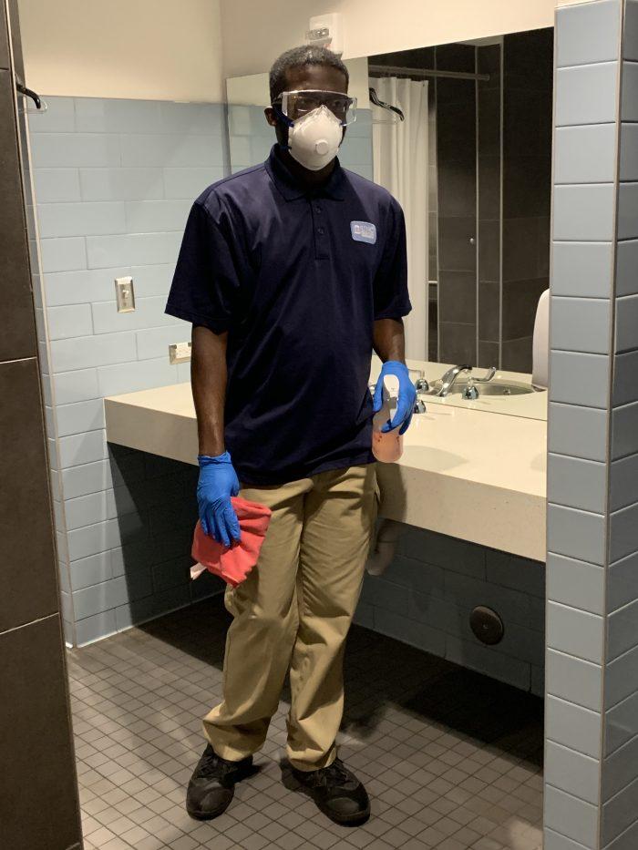 Housekeeper Josh Wilder wears personal protective equipment while working.