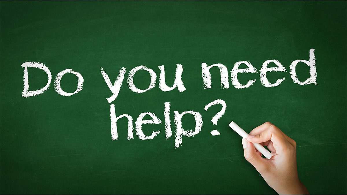 writing on a chalkboard: do you need help