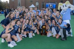The women's field hockey team with their trophy