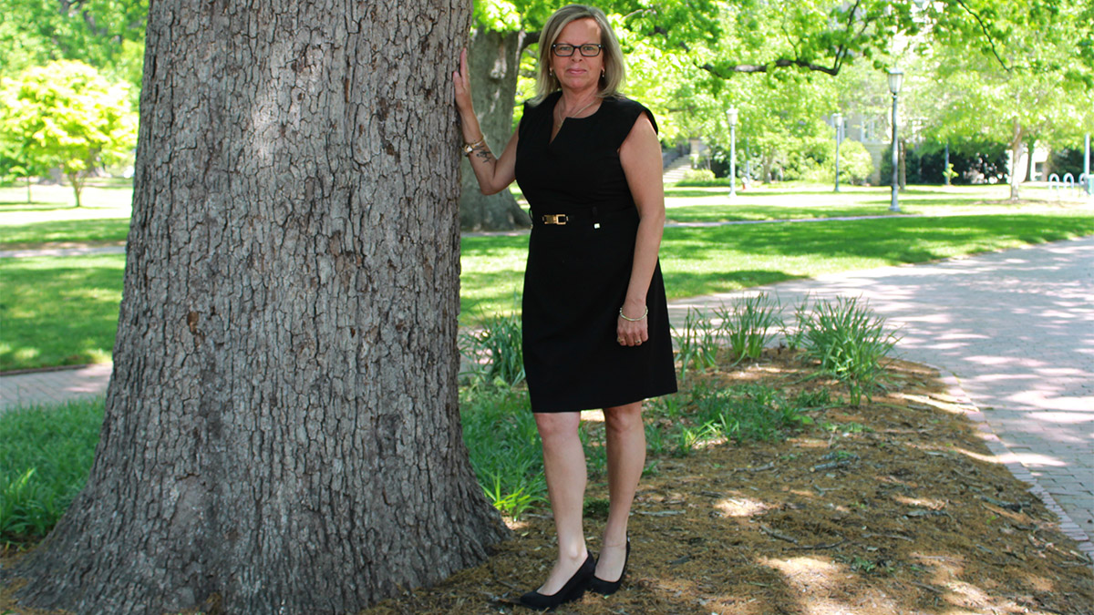 Julie Cannefax posing beside a tree on the UNC-Chapel Hill campus