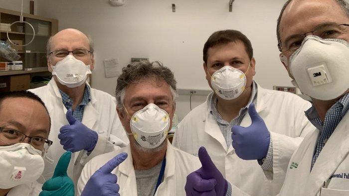 Mask testers Hao Chen, William Bennett, Kirby Zeman, Phillip Clapp, and James Samet wearing a variety of masks.