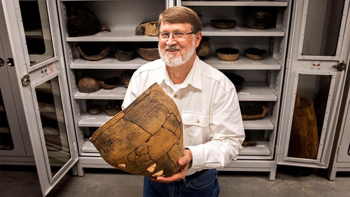 Steve Davis with an artifact