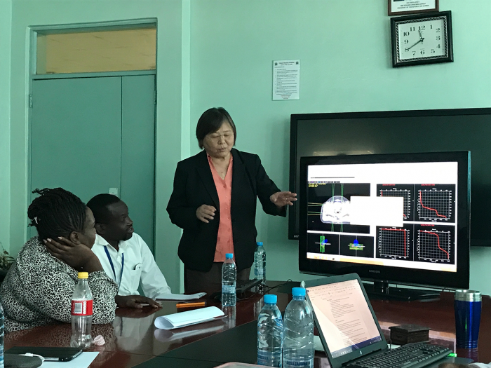 Chang teaching a team of doctors in Zambia.