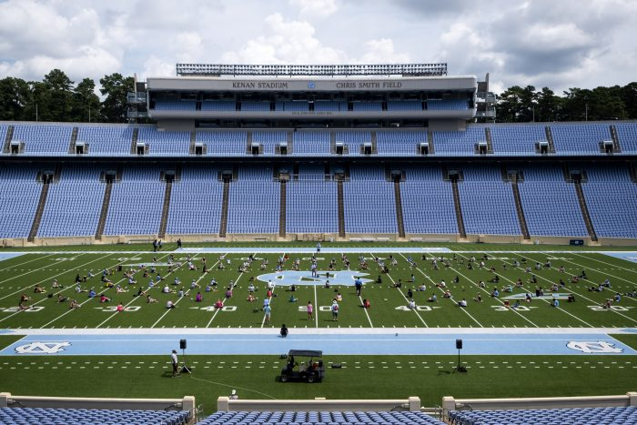 The Marching Tar Heels rehearsing six feet apart in Kenan Memorial Stadium before the University transitioned to remote learning on Aug. 17. (Jon Gardiner/UNC-Chapel Hill)