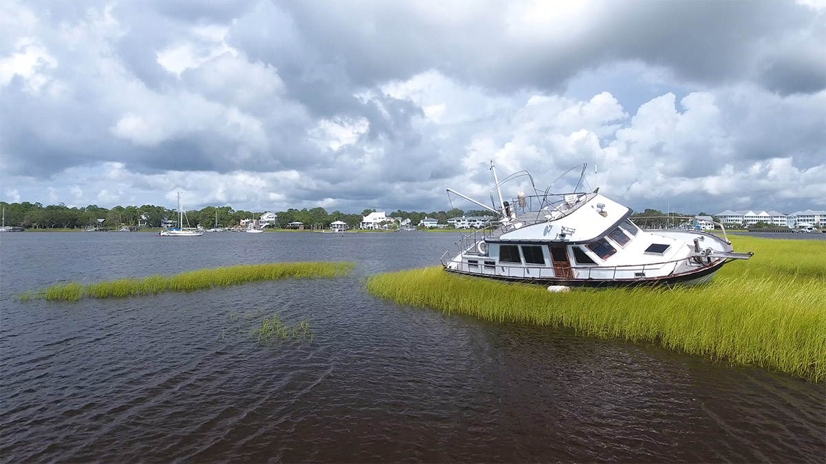 A boat sits stranded in the marshes of Carolina Beach following Hurricane Isaias.