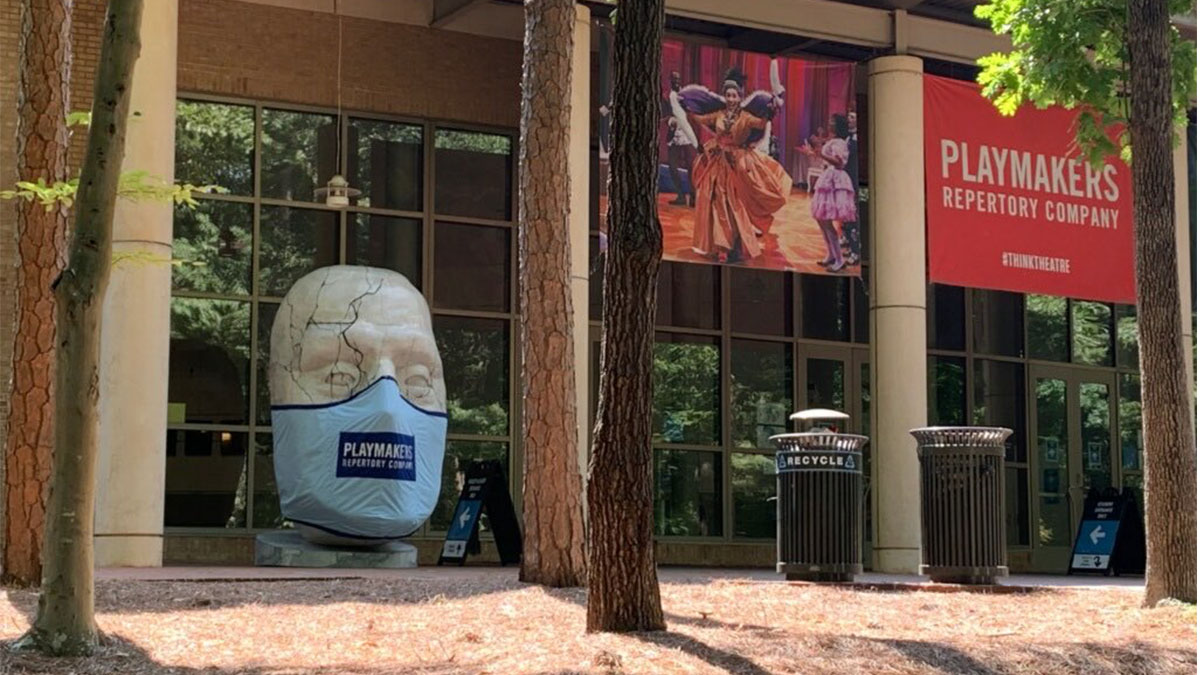A masked statue of Caesar sits outside the Joan H. Gillings Center for Dramatic Art.