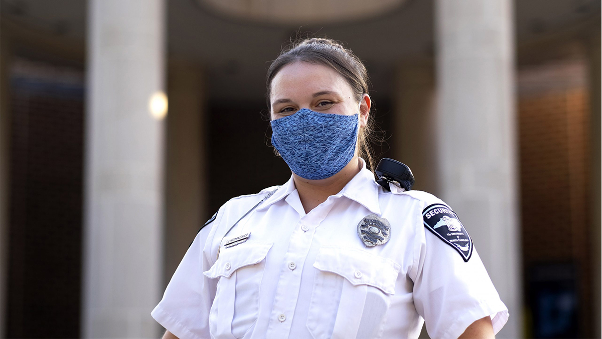 UNC Security Officer Merissa Schumacher wears a mask made by her future mother-in-law. (Jon Gardiner/UNC-Chapel Hill)