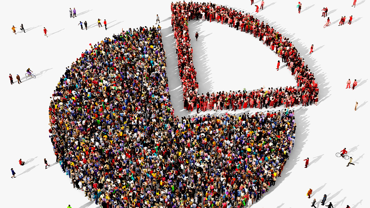 Large and diverse group of people seen from above gathered together in the shape of a pie chart