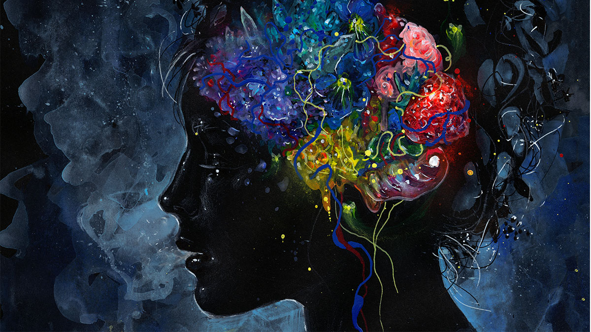 An image of a profile on a dark background with a watercolor painted brain