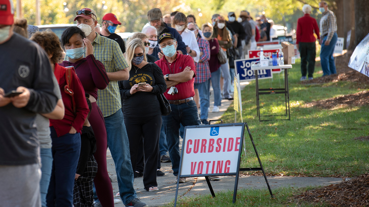 Voters in Wake Forest, North Carolina, wait in line to cast their ballots on Oct. 15, the first day of early voting.
