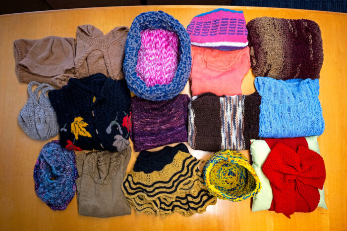 a collection of knitted items