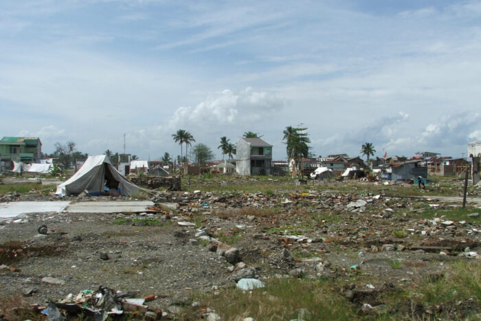 Battered homes and debris continued to cover the landscape in Meulaboh, Indonesia, nine months after the 2004 Indian Ocean tsunami. (photo courtesy of Elizabeth Frankenberg)