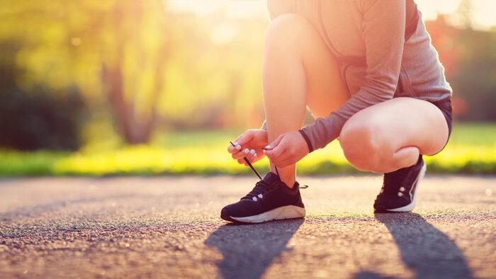 A woman tying running shoes