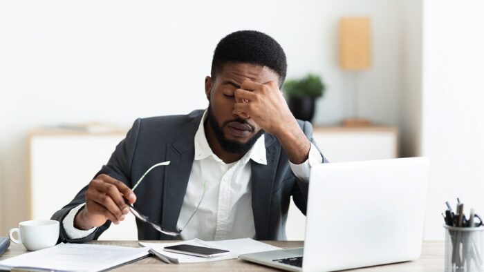 A man looking stressed at work