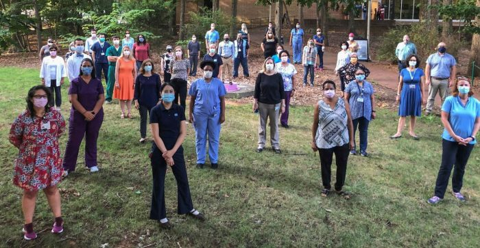 Campus Health employees in PPE gathered outside the James A. Taylor Building, home of Campus Health (Image courtesy of Campus Health)