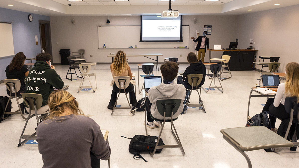 Teaching Assistant Professor Samba Camara leads an Introduction to Africa course (AAAD101) in Fetzer Hall with a class using COVID best practices. (Jon Gardiner/UNC-Chapel Hill)