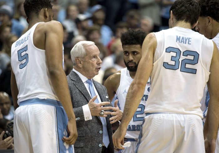 Roy WIlliams speaking with players during a time out.