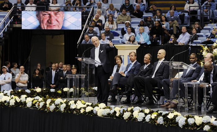 Roy Williams addressing a large crowd.