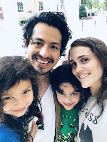 Ramírez with his wife, Kyra, and two children — Milo and Camila — in front of the Old Well on UNC's campus.