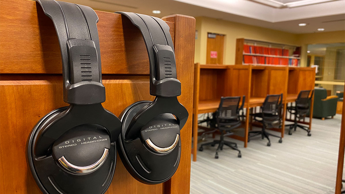 Inside the Media and Design Center, with two pairs of headphones in the foreground.