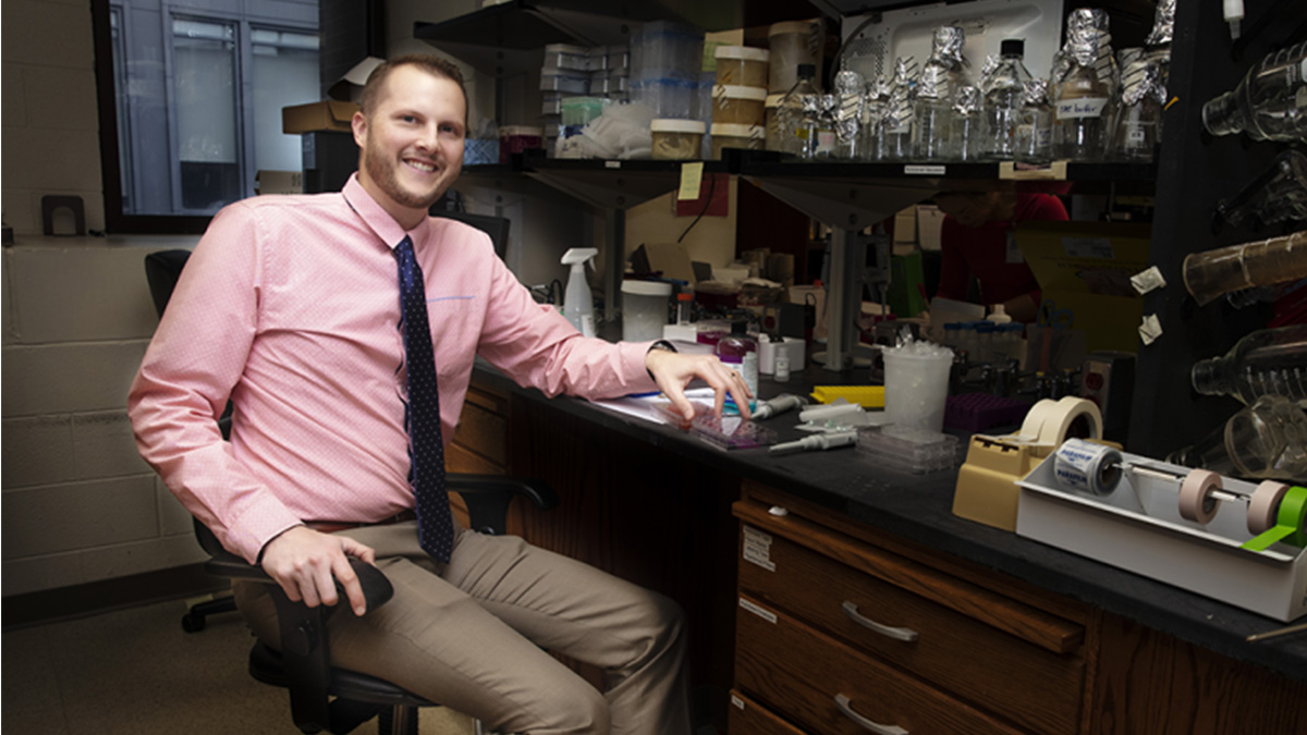 Chad Pecot in his lab in the UNC Linbereger Comprehensive Cancer Center. (Photo by Sarah Daniels/Innovate Carolina)