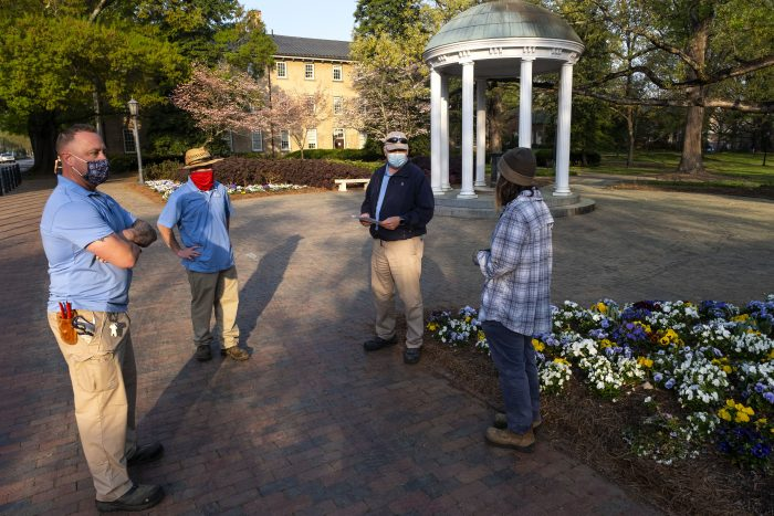 """Peter Ampuja, second from right, checks in with the three crew members, left to right, Eric Tolar, Ryan Talley and Krystal King.They had similar meetings at 7 a.m. every day while they were the only groundskeepers working in the historic campus area. """"During the pandemic the pace of the life changed but the beauty of campus didn't,"""" Ampuja said. """"We continued providing a place for the community to enjoy, and campus visitors appreciate the hard work that Grounds crews put in ast spring. It was nice to have people sometimes stop to say 'thank you' to the crew."""""""