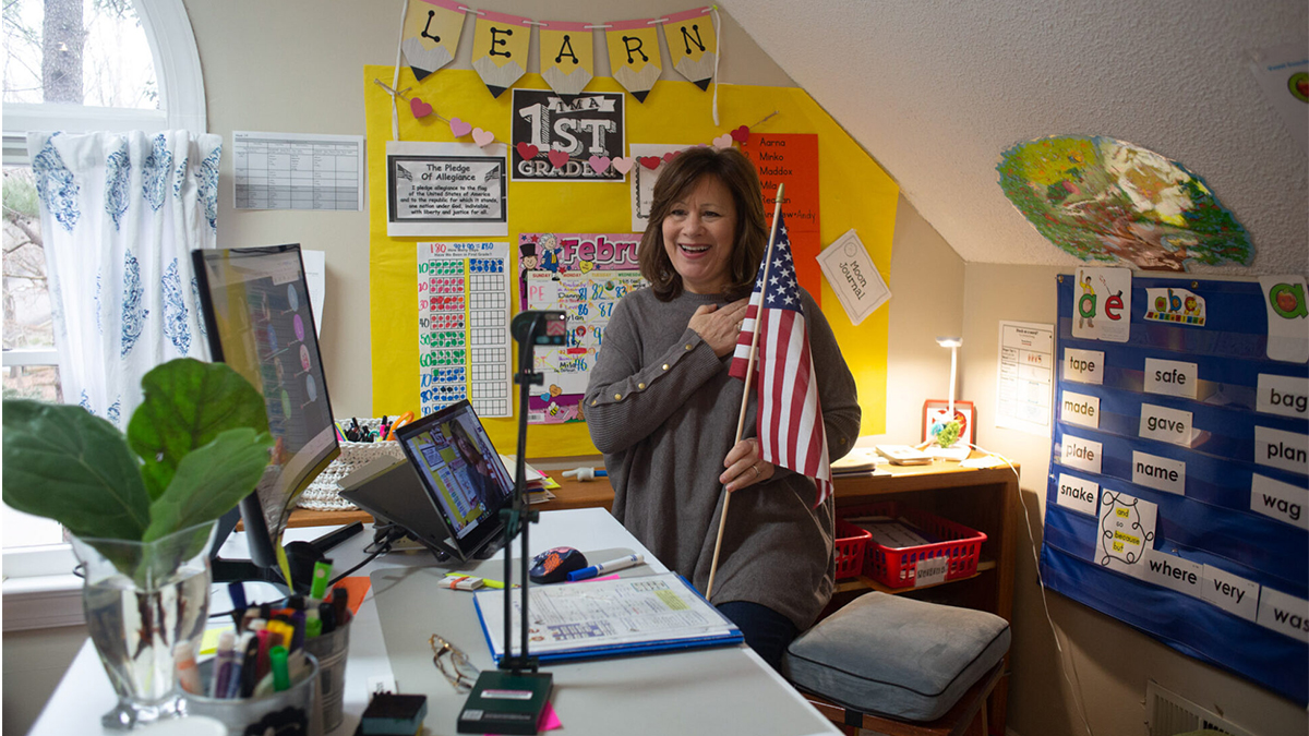 Eva Hagan First grade teacher Suzanne Zaccardo says the pledge of allegiance with her students to start the school day. A teacher in Apex, North Carolina, Zaccardo says that moving her classroom online during COVID-19 has taken a lot of energy, patience, and flexibility. (photo by Eva Hagan)