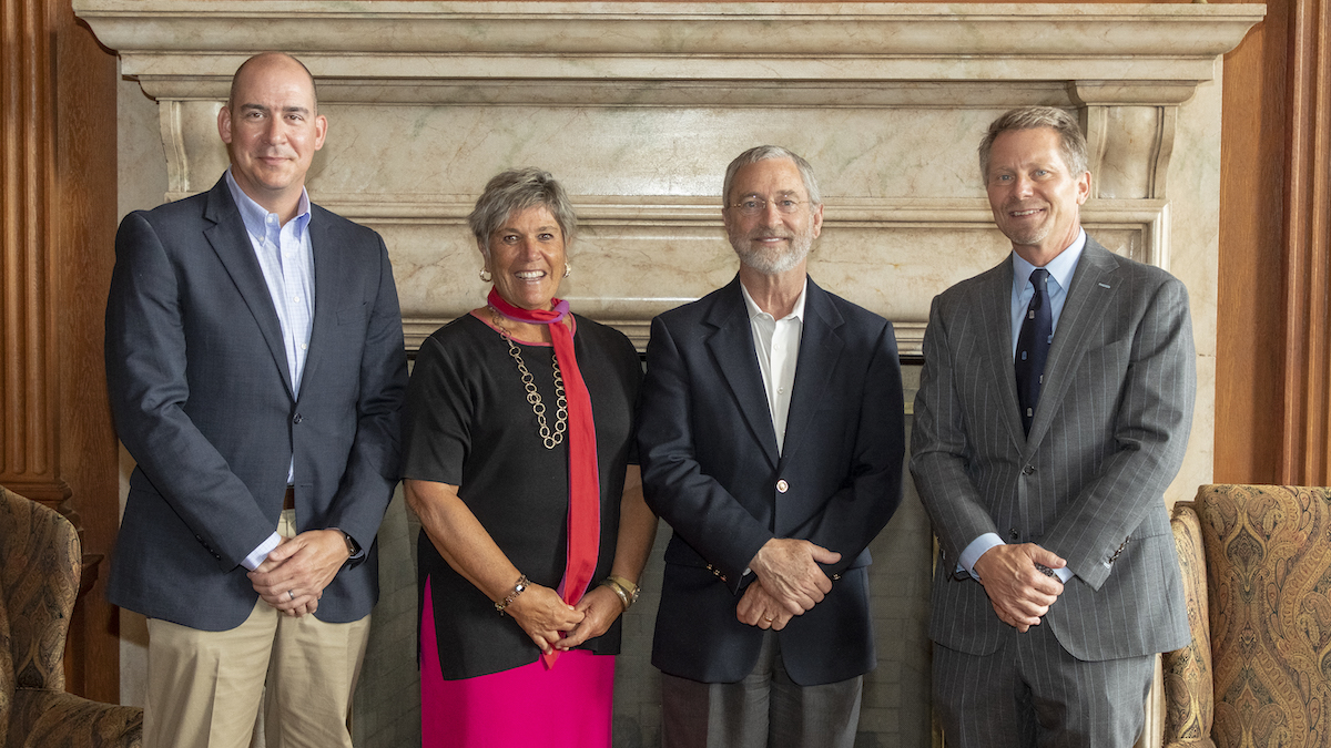 (L-R): Jason P. Mihalik, co-director of the Matthew Gfeller Center; Terry Rhodes, dean of the College of Arts & Sciences; James Kelly, executive director of the Marcus Institute for Brain Health; and Chancellor Kevin M. Guskiewicz.