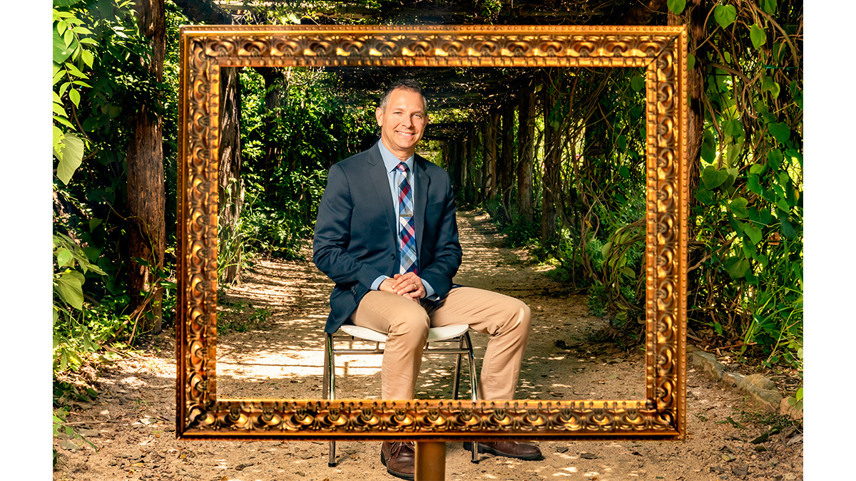Carolina clinical psychology professor Jonathan Abramowitz poses for a portrait under the arbor in Coker Arboretum. (Johnny Andrews/UNC-Chapel Hill)