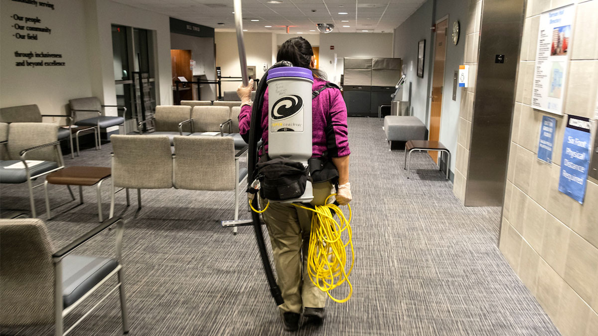 person with a vacuum cleaner on their back