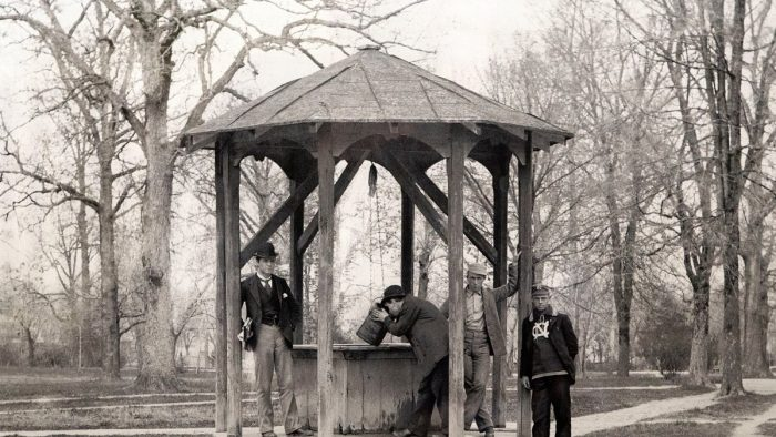 Young men pose in 1892 at what simply know as the well, while one fellow chugs from the bucket. (From Kemp Plummer Battle Photograph Album, #P0100, North Carolina Collection Photographic Archives, Wilson Library, UNC-Chapel Hill.