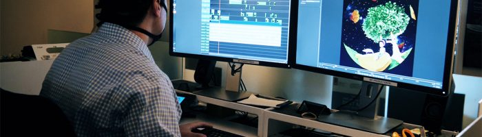 """Digital Production Manager Ben Fox works on Morehead Planetarium and Science Center's new film, """"Mysteries of Your Brain."""""""