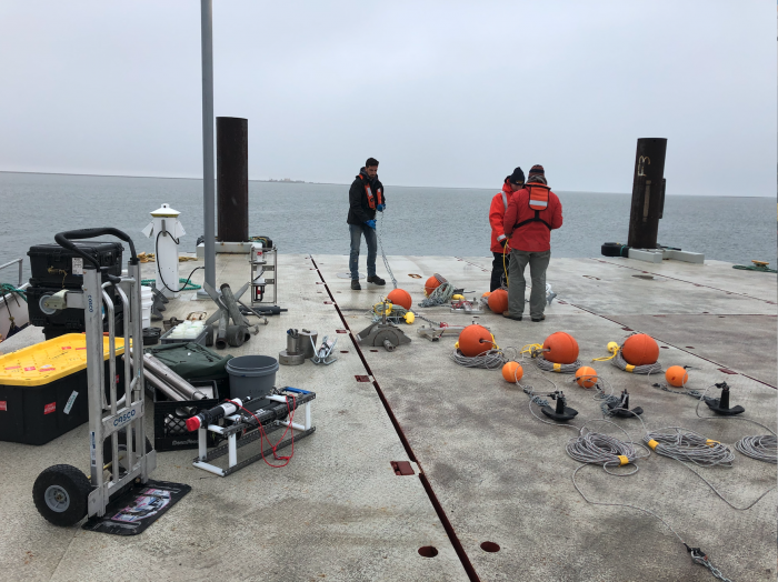 group preparing buoys to be launched into ocean