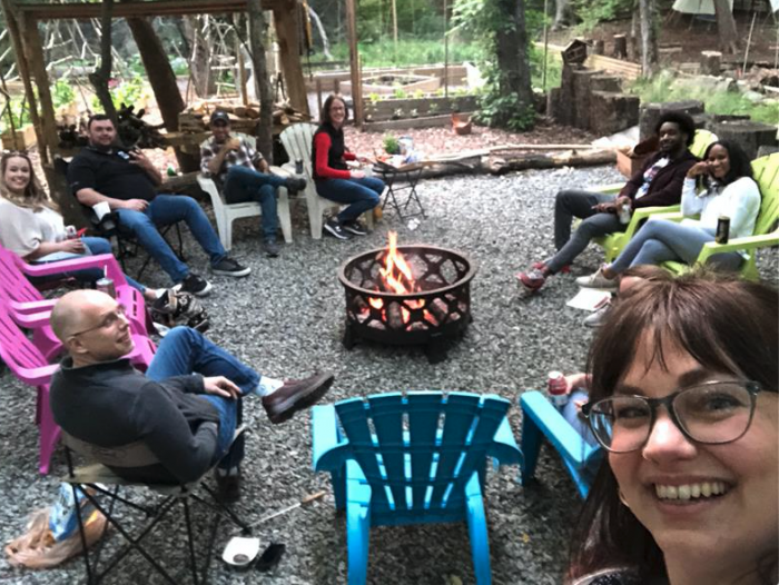 group sitting around a fire