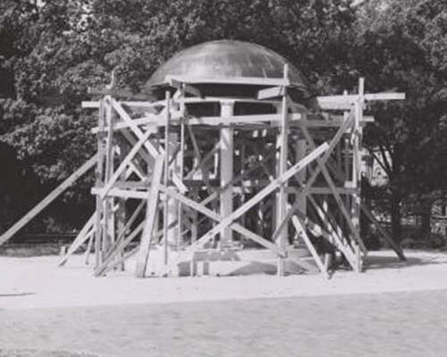 Old Well under construction in 1954 with numerous wooden beams supporting it.