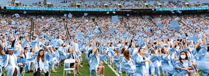 Members of the Class of 2020 toss their caps at the end of their belated Commencement ceremony on Oct. 10.
